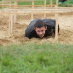 """Передвигаться по пластунски по песку не так просто, как кажется на первый взгляд. Фото: Константин Бобылев, """"Глобус""""."""